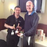 "Alan Stewart presents the prize for ""nearest the pin"" to Eddie McKeever (left)"